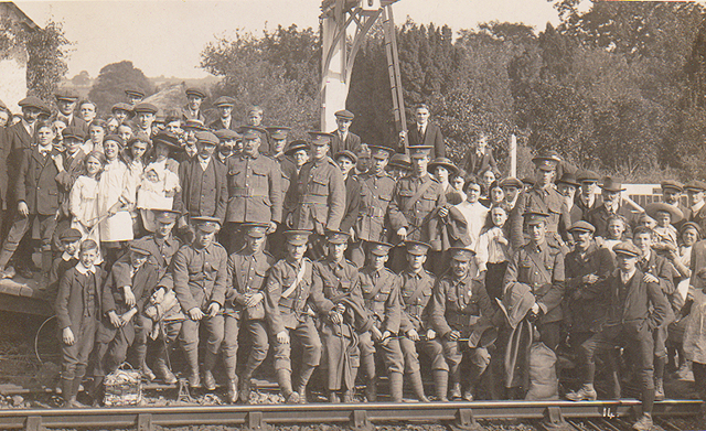1914 - Soldiers waiting for the train from Williton which would take them to the First World War on 1 Otober. Photograph taken and published by H.H. Hole c/o Geoff Clatworthy.