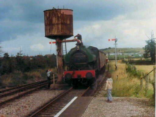 1982 - Bagnall 0-6-0ST No. 2994 Vulcan takes water at Williton. This work is licenced under a Creative Commons Licence. © Brian Hart