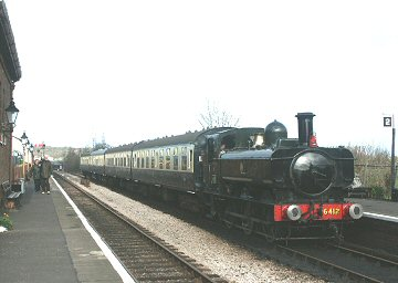 2004 - A timeless scene at Williton as GWR 0-6-0PT No. 6412 pulls in on 18 February. This work is licenced under a Creative Commons Licence. © Peter Darke