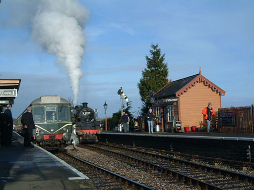 2004 - DMU and BR Standard Class 4 80136 at Williton on 27 December. © Mike Dan