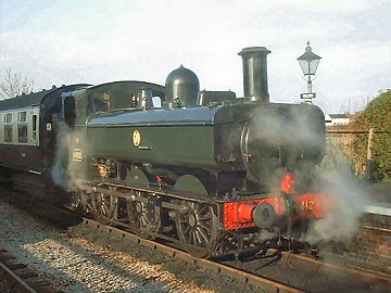 2004 - GWR 0-6-0 No. 6412 arrives at Williton with the first train of the season on 14 February. This work is licenced under a Creative Commons Licence. © Jon Tooke