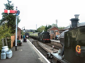 2004 - GWR 2-6-2T No. 5542 at Williton BR Standard Class 4 2-6-4T No. 80136 runs into the down platform on 5 May. This work is licenced under a Creative Commons Licence. © Peter Darke