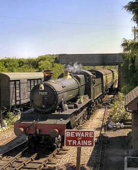 2004 - GWR 4-6-0 No.7820 Dinmore Manor brings the 2.10pm from Bishops Lydeard into Williton on 18 May. This work is licenced under a Creative Commons Licence. © Lawrence Hunt
