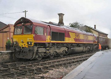 2004 - On a very wet 15 October, the last of the Leigh Bridge stone trains about to set off from Williton for the main line at Norton Fitzwarren, behind no 66036. This work is licenced under a Creative Commons Licence. © Martin Southwood