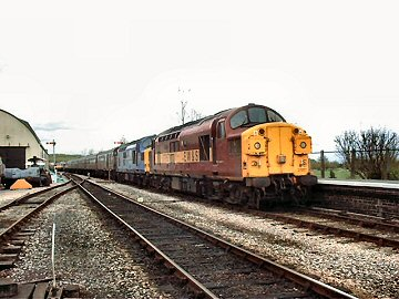 2004 - The Steamy Affairs Atlantic Coast Express from Milton Keynes to Minehead and back - Nos. 37047 and 37057 pass Williton on the return leg on 17 April. This work is licenced under a Creative Commons Licence. © Jon Tooke