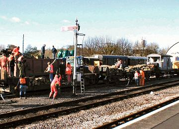 2004 - Unloading the Log Train at Williton on 13 November. This work is licenced under a Creative Commons Licence. © Malcolm Anderson