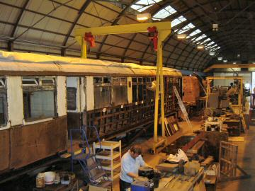 2005 - Auto Trailer No. 169 undergoing restoration at Williton Works in company of the boiler of Braunton on 23 April. This work is licenced under a Creative Commons Licence. © John Wood
