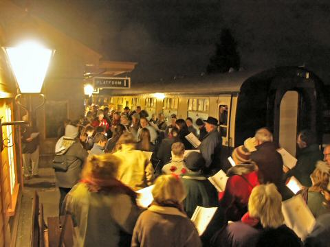2005 - Carollers amassed on the down platform at Williton on the evening of 13 December. This work is licenced under a Creative Commons Licence. © Mike Dunse