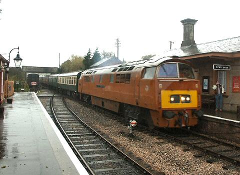 2005 - D1015 Western Champion brings a Weston-Bath-Minehead excursion into Williton on 2 December. This work is licenced under a Creative Commons Licence. © Peter Darke