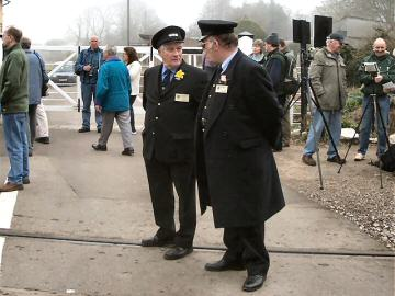2005 - During the Spring Steam Gala, two volunteers man the crossing at a very busy Williton on 19 March. This work is licenced under a Creative Commons Licence. © Chris Phillips