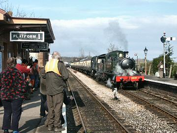 2005 - GWR 2-6-2T No. 5542 and WSR 2-6-0 No. 9351 arrive at Williton with hundreds of protesters who later marched to the District Council offices to complain about the proposed developments at Minehead - pictured on 26 February. This work is licenced under a Creative Commons Licence. © Peter Darke