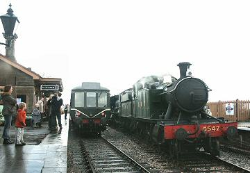 2005 - GWR 2-6-2T No. 5542 and WSR 2-6-0 No. 9351 bring the New Year Day Jumbo train into a wet Williton on 1 January. This work is licenced under a Creative Commons Licence. © Peter Darke