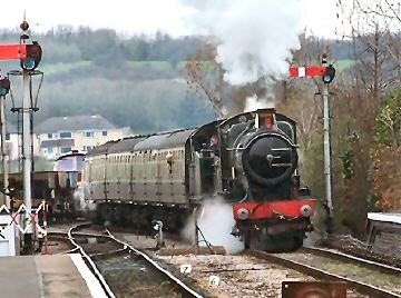2005 - GWR 4-4-0 No. 3440 City of Truro and GWR 2-6-2T No. 5542 arrive at Williton on 27 March. This work is licenced under a Creative Commons Licence. © Terry Bowden