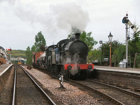 2005 - LNWR 0-8-0 No. 49395 with a chartered goods train at Williton on 3 October. This work is licenced under a Creative Commons Licence. © Fotophile69