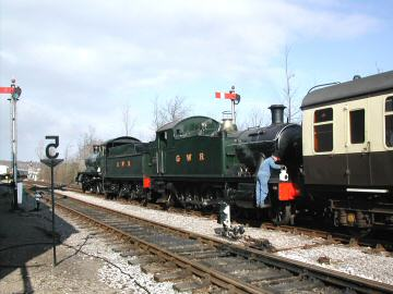 2005 - WSR 2-6-0 No. 9351 and GWR 2-6-2T No. 5542 at Williton on Protest Train duties on 26 February. This work is licenced under a Creative Commons Licence. © Wilf Small