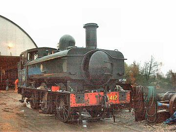 2005 - WSRA owned GWR 0-6-0PT No. 6412 enjoys the rain during a brief spell outside the shed at Williton - pictured on 22 January. This work is licenced under a Creative Commons Licence. © Jon Tooke