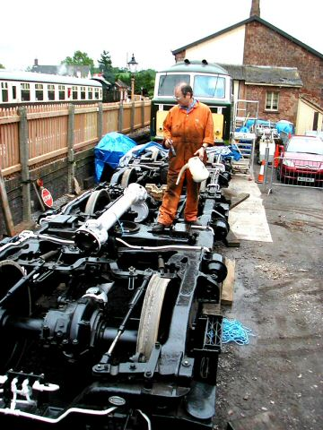 2006 - Oiling the bogies of D7018 at Williton prior to storage under cover on 3rd June - these are due to be reunited with the loco in a few weeks time. This work is licenced under a Creative Commons Licence. © Jon Tooke