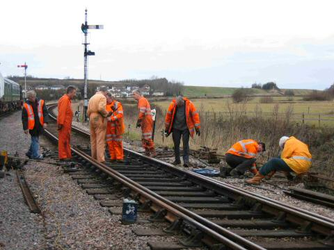 2006 - The Signal and Telegraph gang completing the mechanical connection of the new No 12 point at Williton on 12 February. This work is licenced under a Creative Commons Licence. © Dave Hill