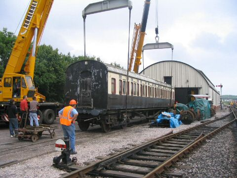 2006 - Two cranes lifting the ex-GWR Toplight coach from an isolated track onto the sidings in the South Yard at Williton on 27 June. This work is licenced under a Creative Commons Licence. © Fenton Fouracre