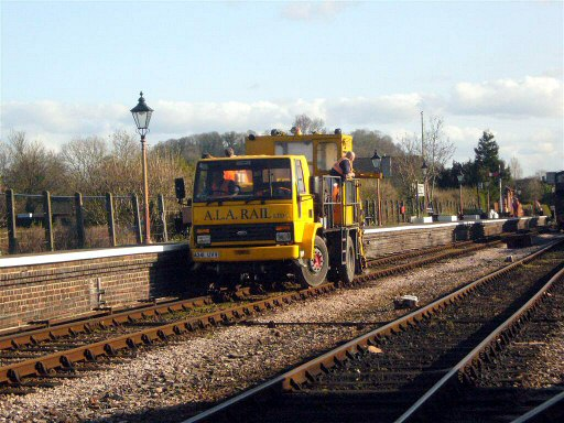 2007 - Brought in to tamp the relays at Watchet and Castle Hill, here is the road-rail vehicle at Williton on 13 March. This work is licenced under a Creative Commons Licence. © JA