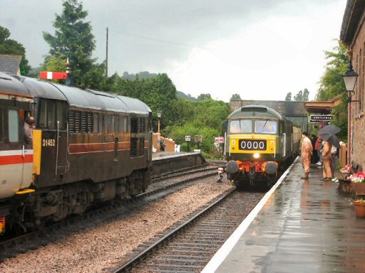 2007 - Class 31 No. 31452 waits with the 11.10am Minehead to Bristol as Class 47 No. D1661 arrives at Williton on 20 July. This work is licenced under a Creative Commons Licence. © Peter Darke