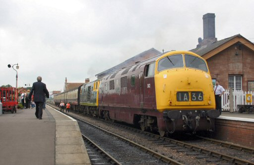2007 - Class 42 Warship D832 and Class 35 Hymek D7076 with the 11.35am to Minehead at Bishops Lydeard on 14 June. This work is licenced under a Creative Commons Licence. © Malc Stacey