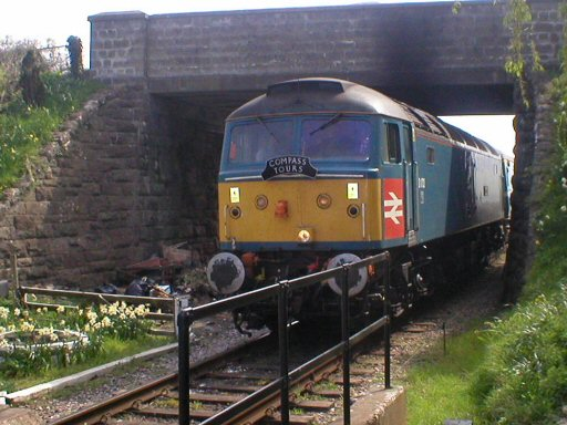 2007 - Class 47 No. 47853 leads the tour from the North West to Minehead under Williton Bridge on 14 April. This work is licenced under a Creative Commons Licence. © Thomas Gulliford
