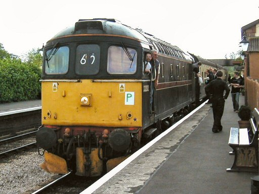 2007 - Driver Graham Perry celebrates passing his driving exam as Crompton no 33202 sports an unofficial sticker and pauses at Williton on 19 May. This work is licenced under a Creative Commons Licence. © Jon Tooke