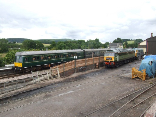 2007 - The DMU sets off for Minehead as D1661 and D7017 look on at Williton on 24 June. This work is licenced under a Creative Commons Licence. © Andy Wray