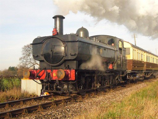 2007 - The Heritage Railway Association Special heads south from Williton behind GWR 0-6-0PT No. 6412 on 4 February. This work is licenced under a Creative Commons Licence. © JA
