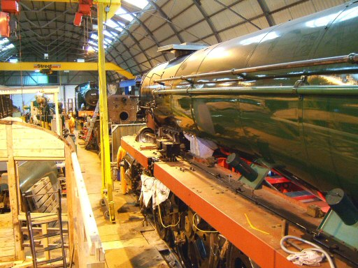 2008 - A view inside the Swindon Shed at Williton with Auto Trailer No. 169, GWR 0-6-2T No. 6695, the boiler of GWR 0-6-0PT No. 6412 and SR 4-6-2 No. 34046 Braunton - seen on 23 January. This work is licenced under a Creative Commons Licence. © Ian Grady