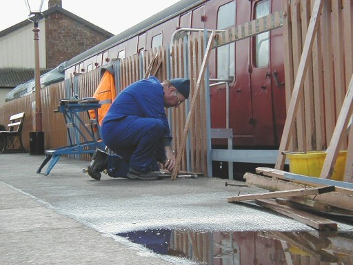 2008 - Dr James is seen at Williton repairing the platform fence and renewing the broken and damaged parts on 28 March. This work is licenced under a Creative Commons Licence. © Jon Tooke