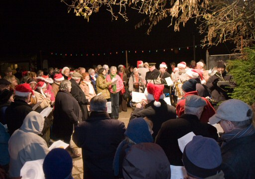 2008 - Massed carollers with a Carol Train at Williton Station on 15 December. This work is licenced under a Creative Commons Licence. © Mike Dunse