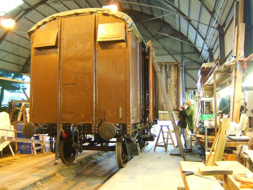 2008 - Members of the 169 working party make a start removing the old doors from Box Van No. B752355 at Williton on 2 March. This work is licenced under a Creative Commons Licence. © Ian Grady