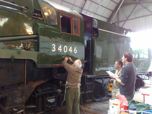 2008 - The signwriter gives identity to SR 4-6-2 No. 34046 Braunton at Williton on 9 September. This work is licenced under a Creative Commons Licence. © Keith Speller