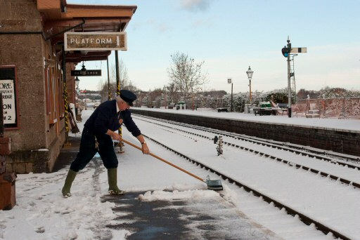 2010 - A member of staff at Williton Station clearing the snow from the down platform on 18 December. This work is licenced under a Creative Commons Licence. © Jacquie Green