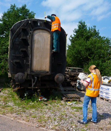 2010 - Claire Sheppy (foreground) is conducting a full structural survey of the Heritage Carriages Project vehicles on 26 June - aided here by Mike Dunse (on carriage). This work is licenced under a Creative Commons Licence. © Mike Dunse