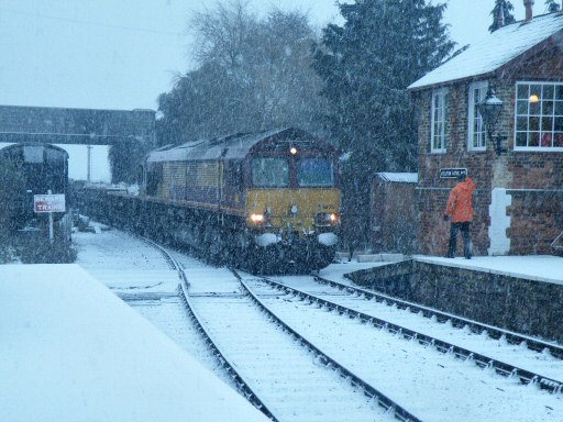 2010 - Class 66 No. 66018 arrives at Williton Station during a heavy snowfall on 17 December. This work is licenced under a Creative Commons Licence. © Thomas Gulliford
