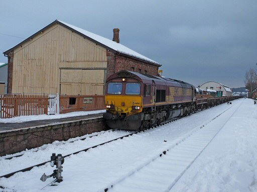 2010 - Class 66 No. 66018 with the stone empties standing wrong road at Williton due to frozen points on 22 December. This work is licenced under a Creative Commons Licence. © Bradley Cottrell
