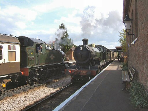 2010 - GWR 2-6-2T No. 5553 waits with an up train at Williton Station on 10 May 2010 as GWR No. 3850 arrives with a Minehead-bound train. This work is licenced under a Creative Commons Licence. © Ian Grady
