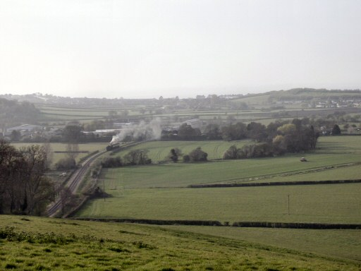 2010 - GWR 2-8-0 No. 3850 leaving Williton with an two-coach evening special on 24 April as viewed from the north slope of Castle Hill. This work is licenced under a Creative Commons Licence. © Aaron Manley