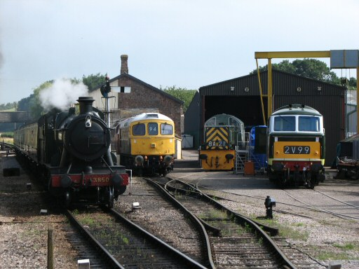 2010 - GWR 2-8-0 No. 3850 waits at Williton on 23 July. Nos. D6566, D9526 and D7017 in the South Yard. This work is licenced under a Creative Commons Licence. © Ashley Gray