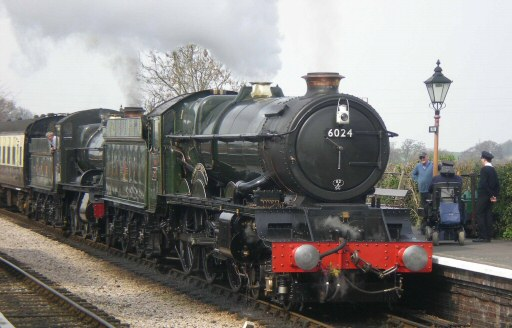 2010 - GWR 4-6-0 No. 6024 King Edward I joined WSR 2-6-0 No. 9351 with the 2.15pm from Minehead on 10 April and seen here at Williton Station. This work is licenced under a Creative Commons Licence. © Rob Hickerton