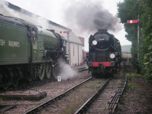 2010 - LNER 4-6-2 No. 60163 Tornado waits at Williton as SR 4-6-2 No. 34046 Braunton arrives on 5 September. This work is licenced under a Creative Commons Licence. © Steve Johns