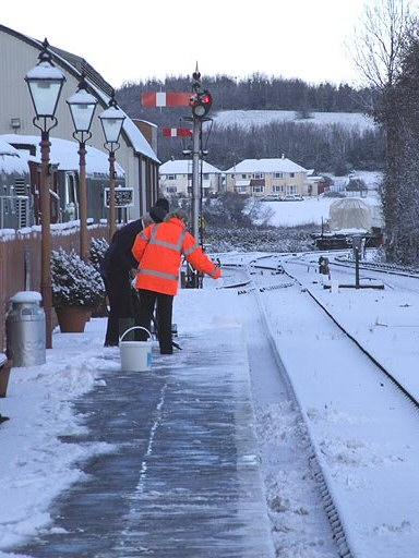 2010 - Members of staff at Williton Station clearing the snow from the down platform on 18 December. This work is licenced under a Creative Commons Licence. © Martin Southwood
