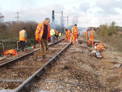 2010 - Minus 6 but the low temperature doesn't stop the WSRA PW Gang seen here engaged in changing sleepers near Williton on 28 November. This work is licenced under a Creative Commons Licence. © Malcolm Anderson