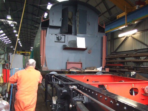 2010 - Notable progress is being made with the tender for SR 4-6-2 no 34046 Braunton. Here the tank is being fitted to the frames on 29 December. This work is licenced under a Creative Commons Licence. © Ray Waldron
