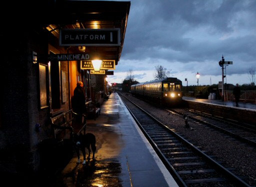 2010 - The DMU pauses at Williton Station at dusk on 14 November. This work is licenced under a Creative Commons Licence. © David Soper
