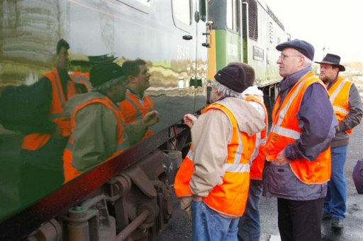 2010 - The Dartmoor Railway Carriage and Wagon group visit included Williton shed. Here they admire the finish on Braunton's support coach on 30 March. This work is licenced under a Creative Commons Licence. © John Scotney
