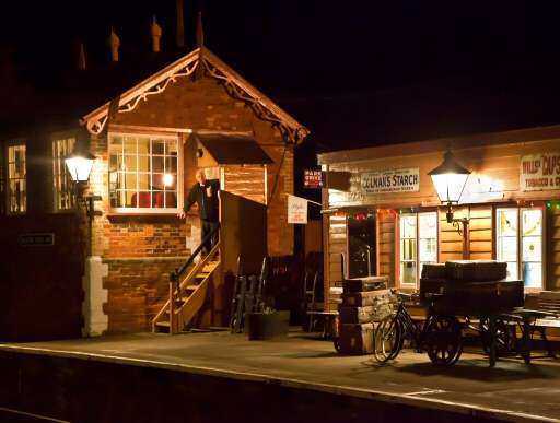 2010 - The Signalman watches over proceedings at Williton Station on the evening of 14 December. This work is licenced under a Creative Commons Licence. © Mike Dunse